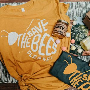 a bee-themed gift set including a t-shirt, honey and other gifts