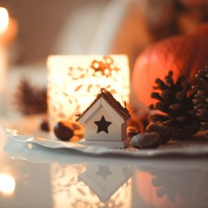 holiday decor such as pinecones, candles, and a miniature house