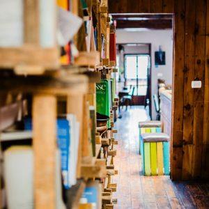 Photo of books on wooden shelves