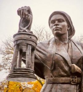 Photo of a statue of Harriet Tubman with a lantern