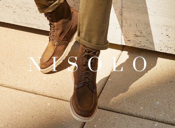 Photo of brown lace up boots with the text 'Nisolo' on top for Shopping Good post