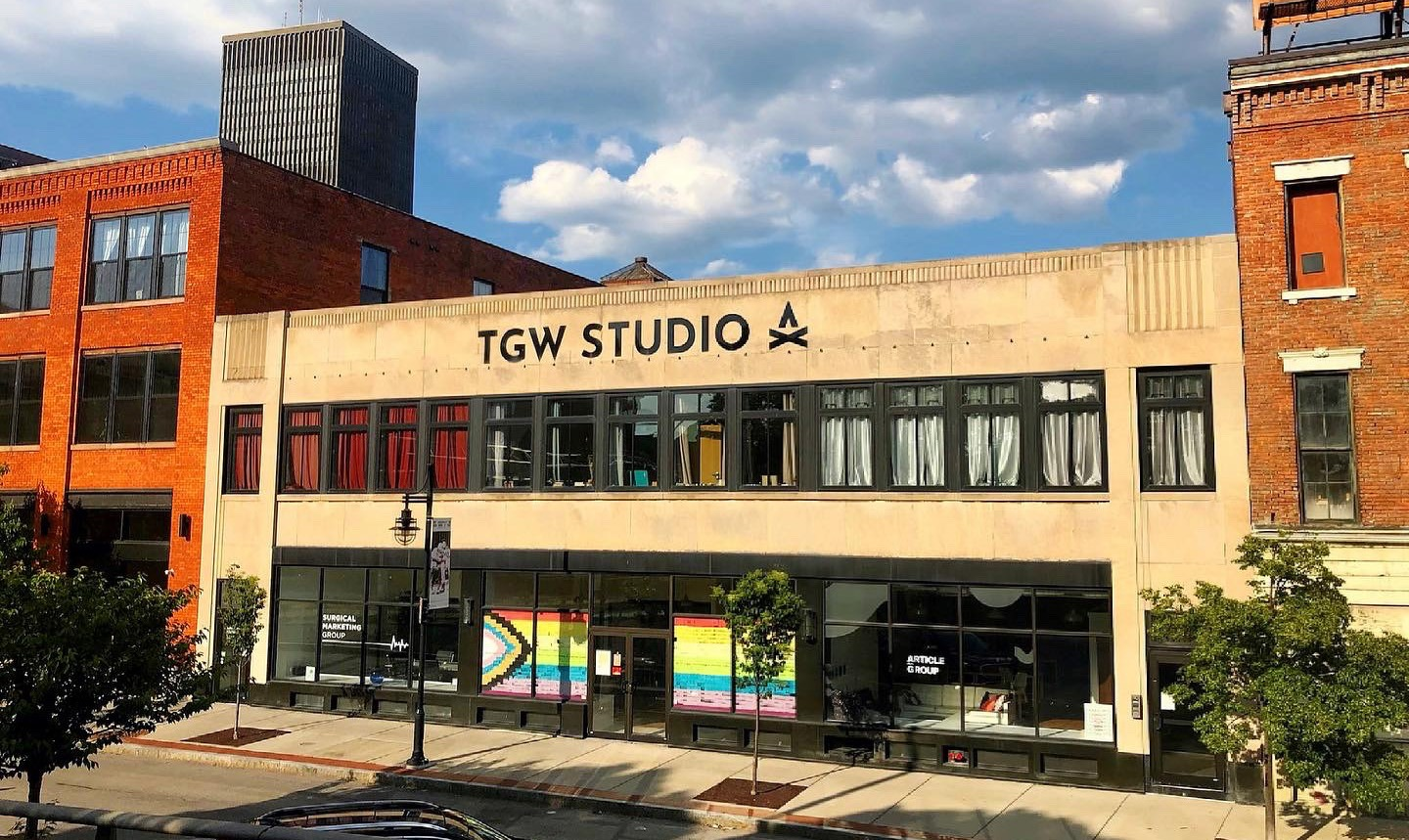 TGW Studio: its windows covered in post-it notes so they create the Inclusive Pride flag