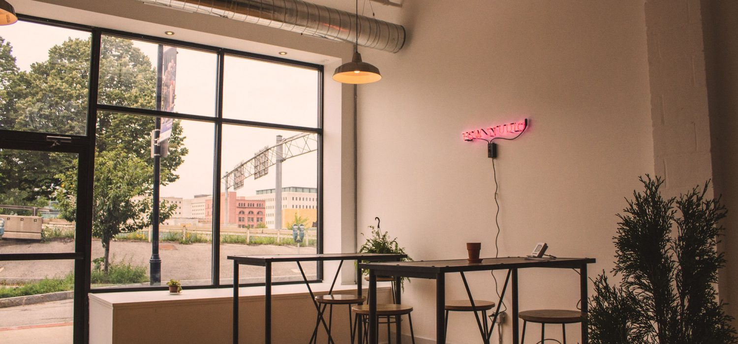 Interior of TGW Studio, looking out window to Rochester's downtown.
