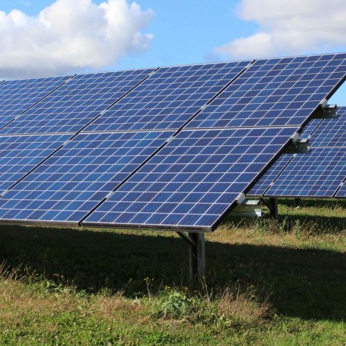 Photo of two ground mounted solar arrays